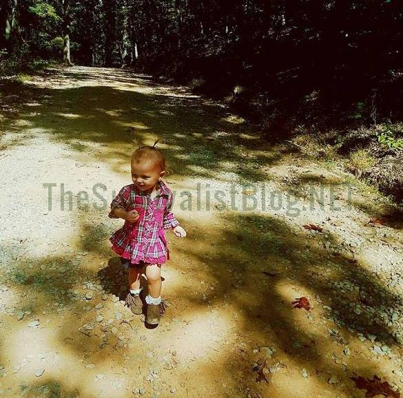 auddie walking by herself in the woods