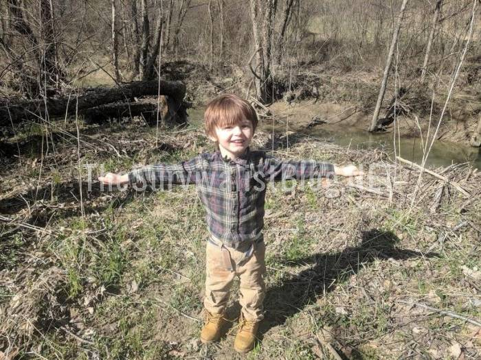 child excited after finding the creek