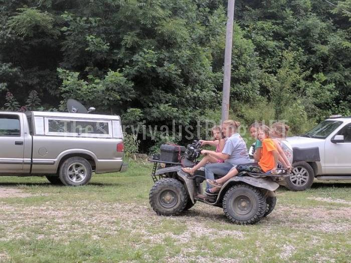 woman and children on ATV