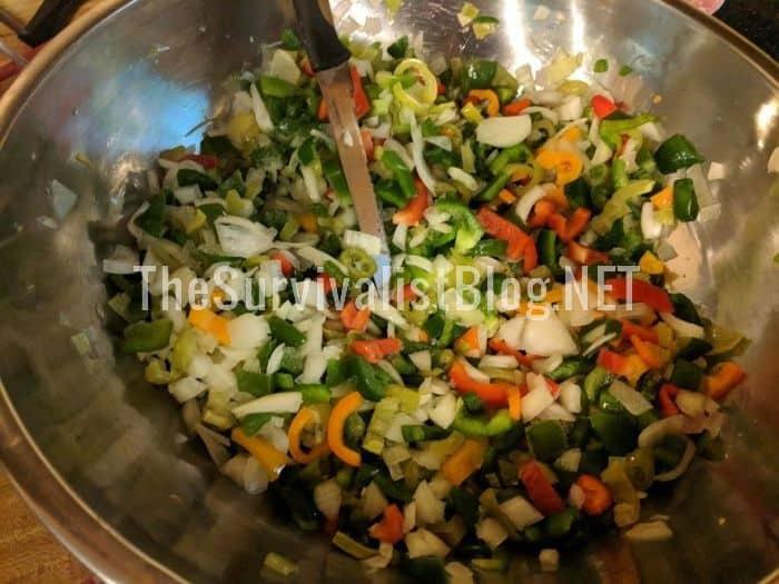 mixing veggies into a bowl to make homemade salsa
