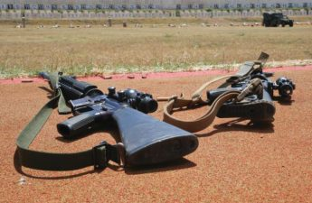 guns with attached slings