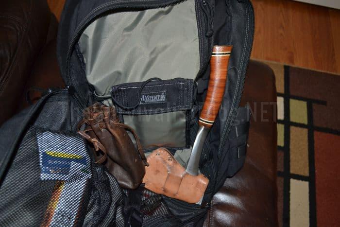 hatchet inside a survival bag