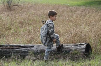 boy wearing camouflage clothes