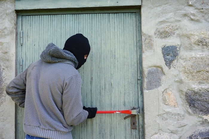 thief breaking into a house