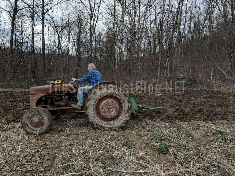using a tractor to plow the garden