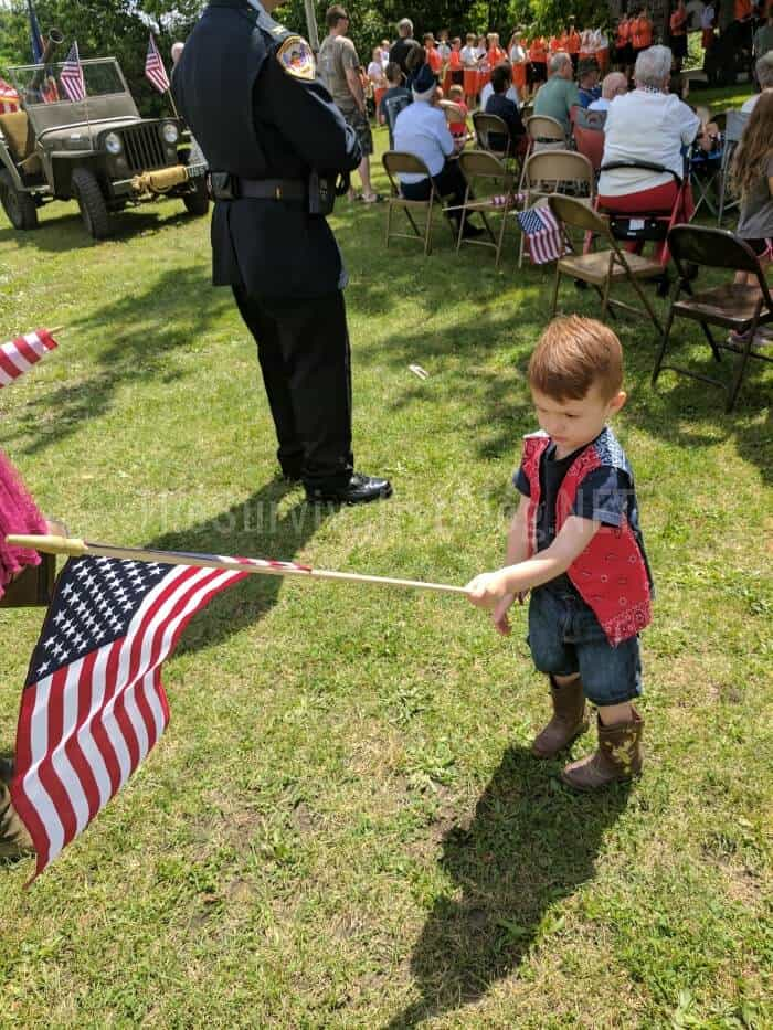 little boy waving the American flag