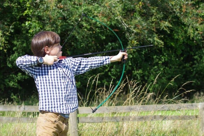 boy shooting a bow