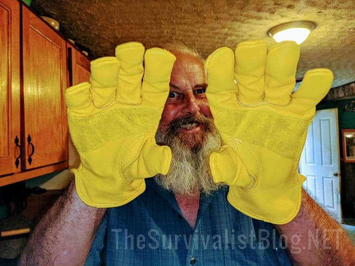 man wearing leather work gloves