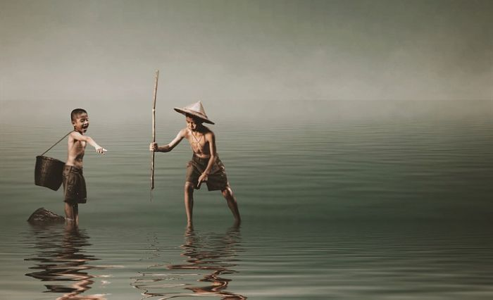 two Vietnamese boys spearfishing