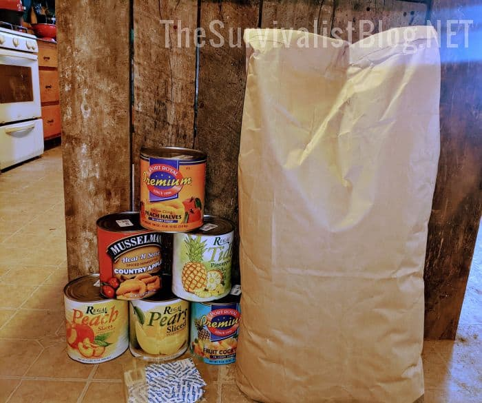 cans of fruit and 50 pounds of potato flakes